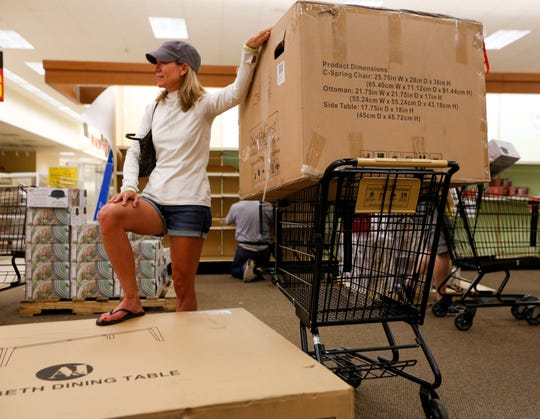 Teri Fechter of Little Chute looks on during the final day of business at Shopko in Appleton on Sunday.