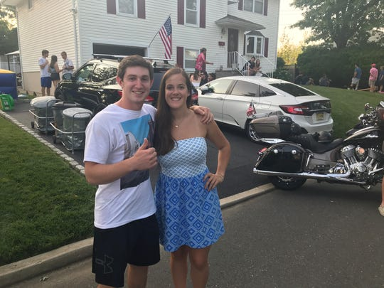 "Tom Bocco, 18, is seen here with his girlfriend Jeannine DeMarzo, in front of his Oceanport home after his graduation party was briefly declared a ""mass casualty incident"" by authorities. The chief of police said authorities probably overreacted out of an abundance of caution."