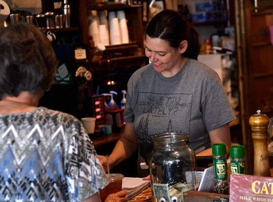 Kasity Grose chats with a customer while filling her order at Waverly's Coffee & Gifts in Cisco on June 14.