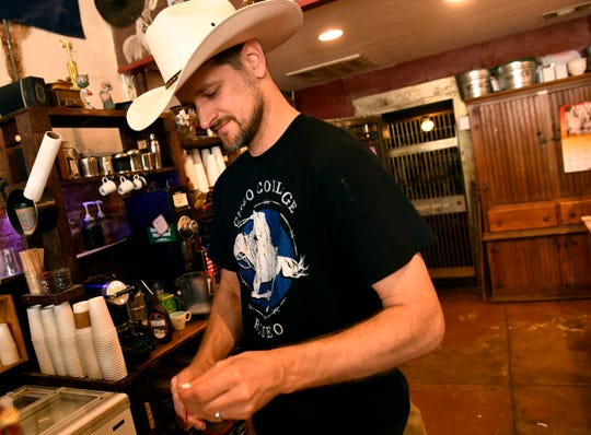 Sean Grose makes a caffeinated beverage at Waverly's Coffee & Gifts in Cisco on June 14. Sean and his wife, Kasity, are selling their shop, hoping to start a new chapter in their life.