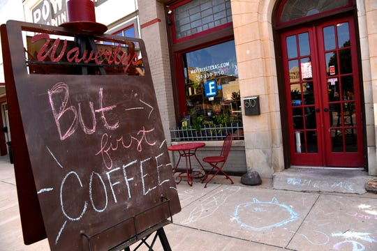 A sign directs customers to Waverly's Coffee & Gifts in Cisco.