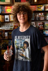Caleb Fairbanks, 17, pauses momentarily for a portrait after getting a drink June 14 at Waverly's Coffee & Gifts. In the seven years since the shop was opened, it has become an anchor for downtown Cisco and a crossroads for all ages.