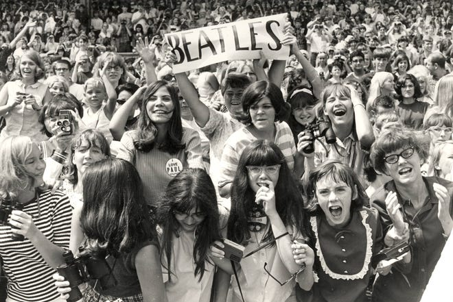 Beatles fans scream and shout for the Fab Four at the concert at Crosley Field on Aug. 21, 1966. It was one of the last shows by the band.