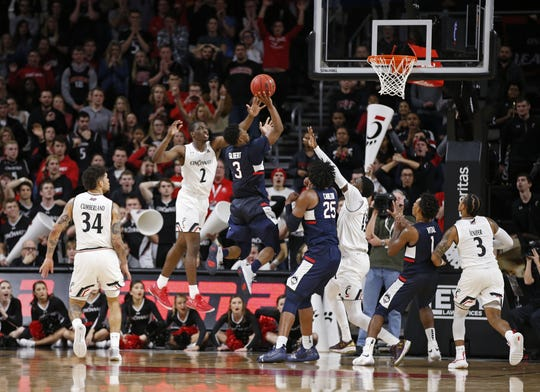 Connecticut Huskies guard Alterique Gilbert (3) puts up the shot to tie the game and send it t overtime against Cincinnati Bearcats guard Keith Williams (2) during the second half of a basketball game Saturday, Jan. 12, 2019 in Cincinnati. Cincinnati won 74-72 in overtime.