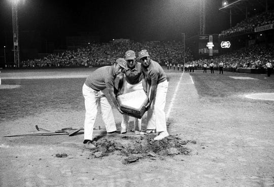 Home plate is removed after the Reds' final game at Crosley Field on June 24, 1970. It was transported to the new Riverfront Stadium for the first game there on June 30.