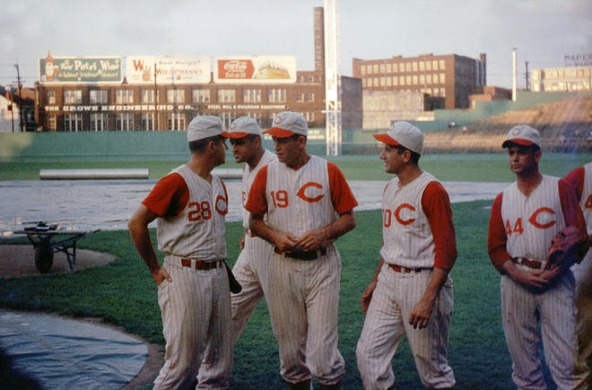 From left, Reds players Eddie Miksis (No. 28), Don Newcombe, Dee Fondy and Alex Grammas gather at Crosley Field during Camera Day in 1958.