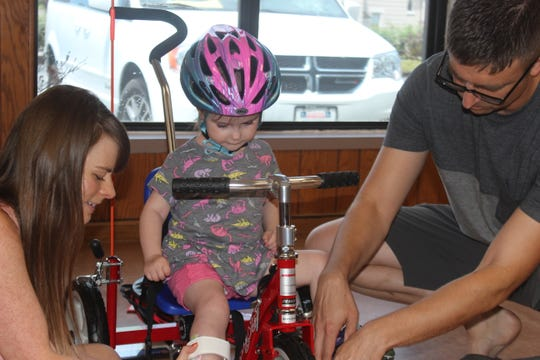 3-year old Samantha Kruse gets fitted for her new adaptive tricycle on June 22, 2019.