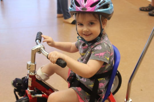 3-year old Samantha Kruse rides her new adaptive tricycle on June 22, 2019.