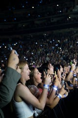 Fans watch as Shawn Mendes plays during his tour stop at Wells Fargo Arena on Saturday, June 22, 2019, in Des Moines.