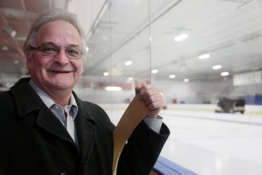 """Olympic Gold Medalist Mark Wells, 56, of Harrison Township poses for a portrait at the St. Clair Shores Civic Arena Wednesday Feb. 19, 2014. Wells was on the USA Olympic team that won the Gold Medal in 1980, known as the """"miracle on Ice."""""""
