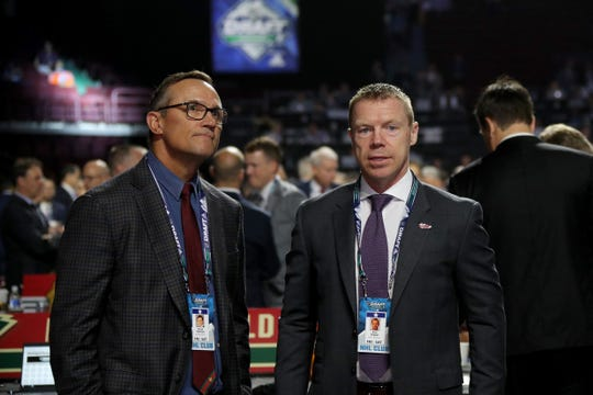 Steve Yzerman and Kris Draper attend the NHL draft at Rogers Arena on Saturday.