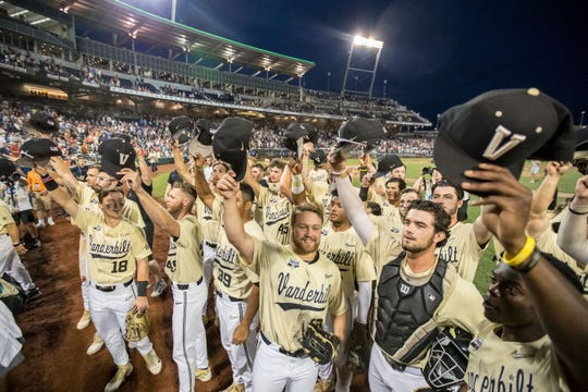 Vanderbilt players salutes their fans after a victory over Louisville on Friday, sending the Commodores to the CWS championship series.