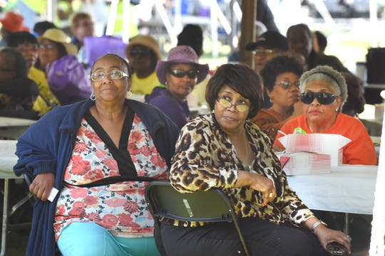 Ida Clayben, center, 69, of Detroit listens as names are drawn during a raffle at the  Wayne County Senior Services Senior Funfest on Saturday, June 22, 2019.