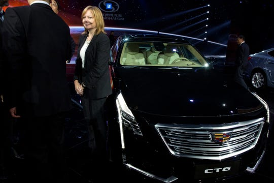 In this April 19, 2015, file photo General Motors CEO Mary Barra stands next to the Cadillac CT6 luxury sedan during a General Motors event ahead of the Auto Shanghai show in Shanghai, China.