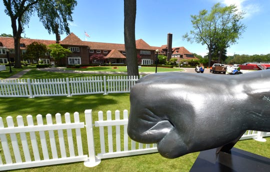 A miniature Joe Louis fist is displayed between the front of the clubhouse and the 10th tee on Sunday at Detroit Golf Club as prep work continues for the Rocket Mortgage Classic.