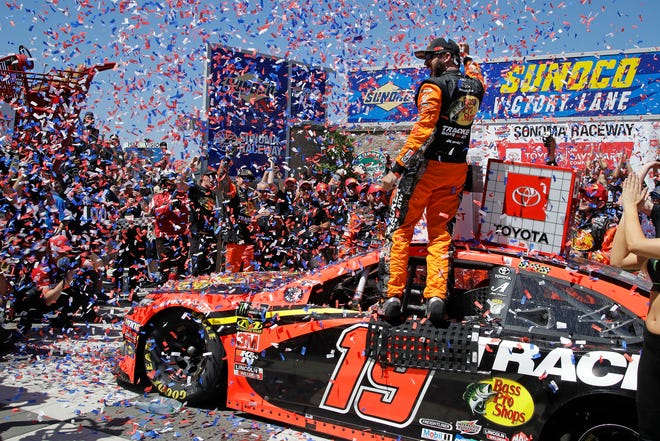 Martin Truex Jr. celebrates after winning   the NASCAR Sprint Cup Series race in Sonoma, Calif., for the second straight year.