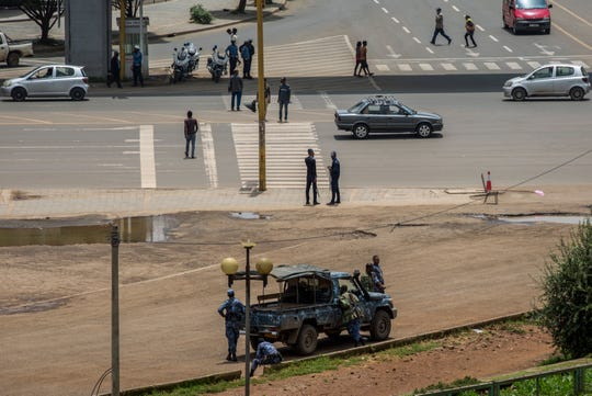 Security forces stand guard in Meskel Square in central Addis Ababa, Ethiopia Sunday.