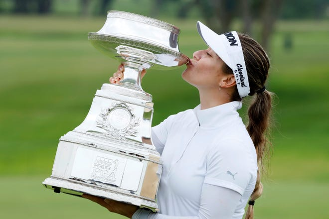 Hannah Green kisses the trophy after winning the KPMG Women's PGA Championship on Sunday.