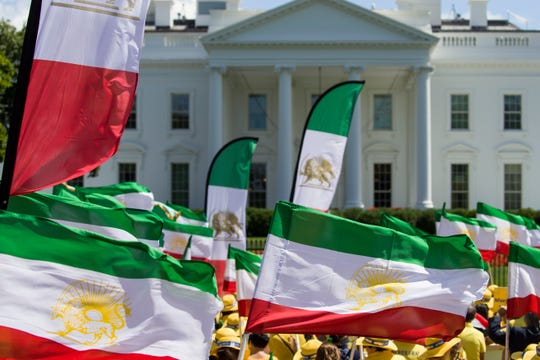Activists gather at the White House, after marching there from the State Department, to call for regime change in Iran, Friday, June 21, 2019, in Washington.