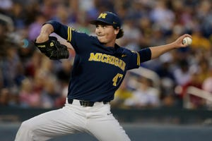 Tommy Henry will get the ball for Michigan in Monday's College World Series championship opener against Vanderbilt.