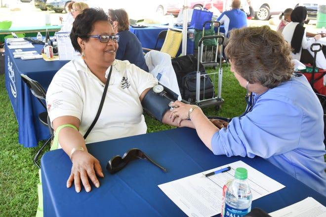 Viruth Watts (left), 59, of Detroit, gets a blood pressure screening by Diane Upplegger of Henry Ford Hospital in Wyandotte during the Wayne County Senior Services Senior Fun Fest on Saturday, June 22, 2019.