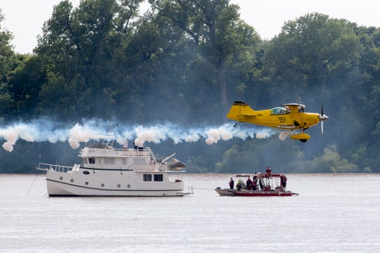 Bob Richards flies near the rescue boats in a Pitts S1S biplane during the 2019 ShrinersFest in Downtown Evansville, Ind., Saturday, June 22, 2019. The air show won't be happening this year according to officials and they are planning on a revised festival in 2021.