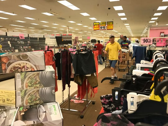 Shoppers at Fond du Lac's Shopko race for deals on the store's final day, June 23, 2019.