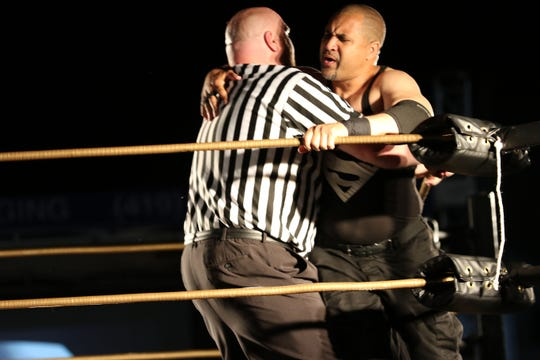 """Superman Lover is restrained by a referee during """"Fight 4 Fremont III,"""" the outdoor June event that ends Live Pro Wrestling's season."""