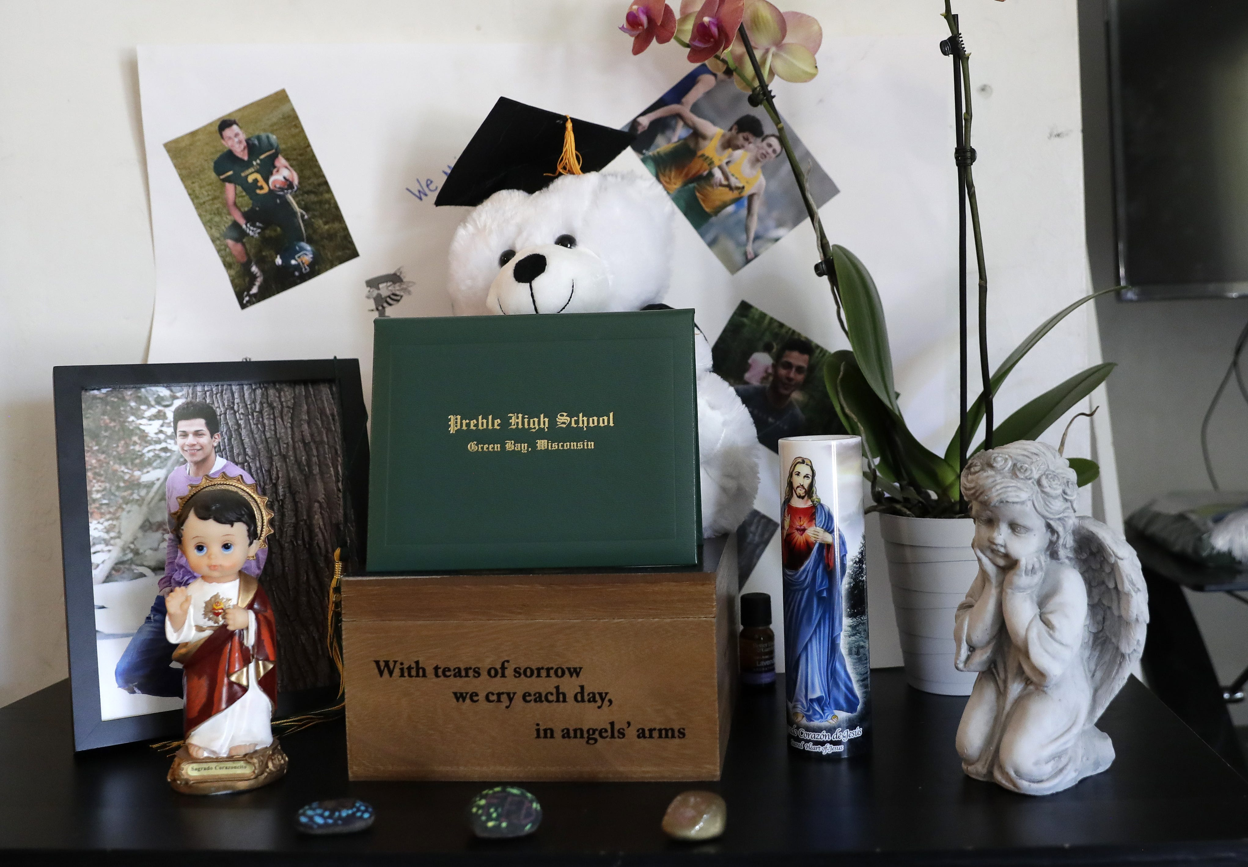 A honorary Preble High School diploma and other mementos for Federico Abarca Jr. sit on a table in his family's living room in Green Bay.