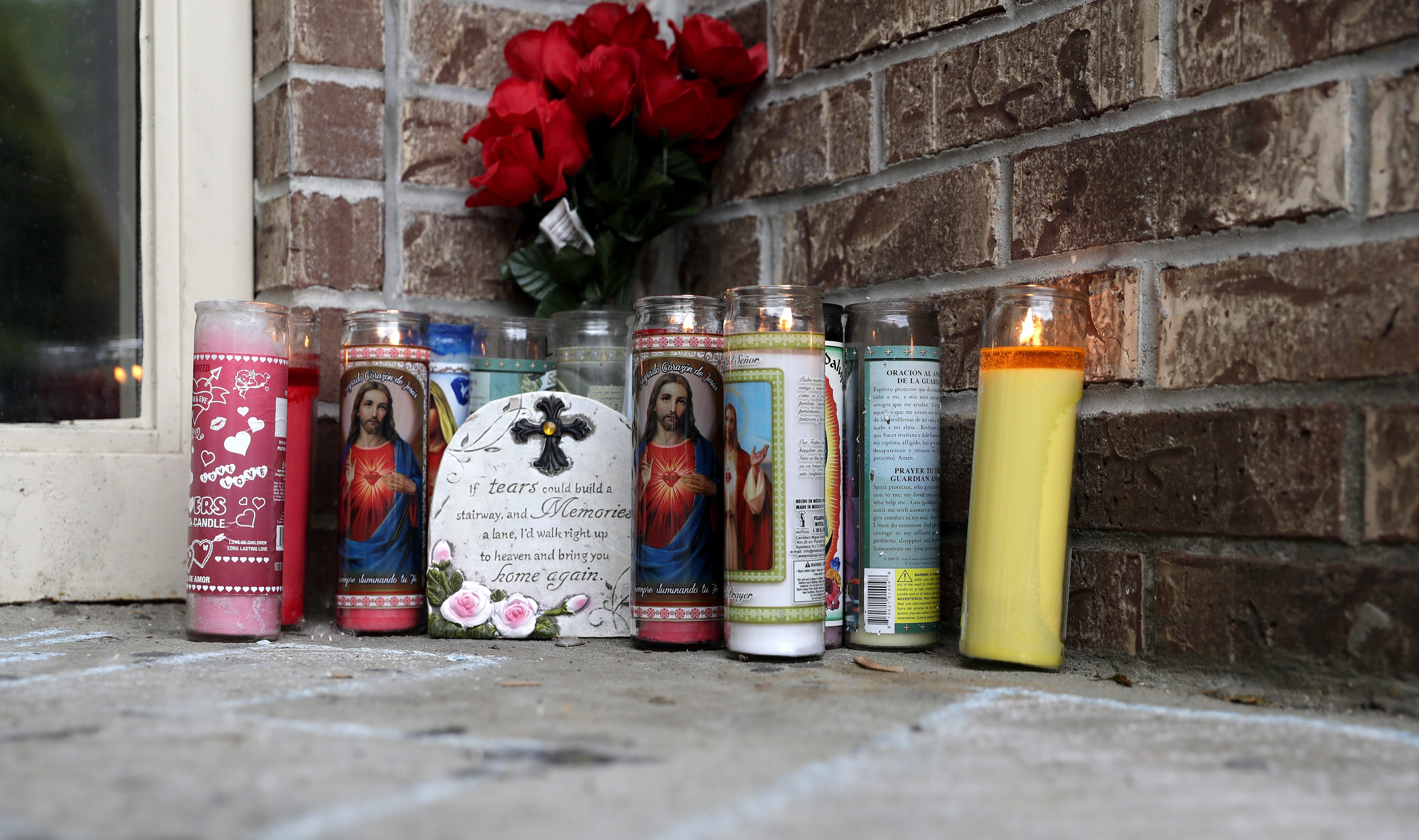 A memorial for Federico Abarca Jr., who was killed in February 2019, sits outside his home in Green Bay.