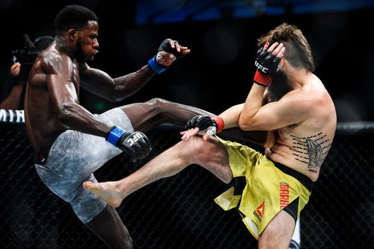 Randy Brown, left, delivers a kick to Bryan Barberena during their welterweight bout on UFC Fight Night at the Bon Secours Wellness Arena Saturday, June 22, 2019.