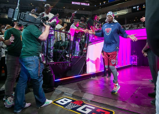 Tri-State player Bonzi Wells (6) jumps and high-fives fans as he runs onto the court during the Big 3 game at Bankers Life Fieldhouse, Indianapolis, Sunday, June 23, 2019.