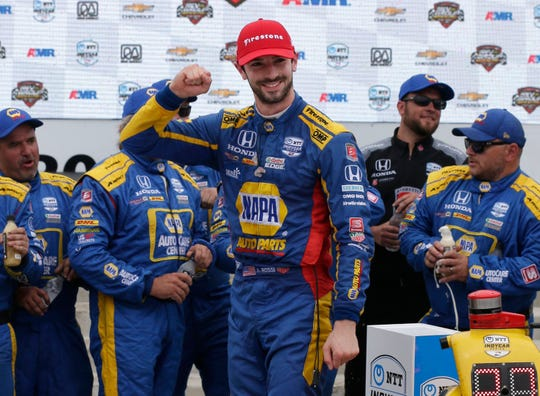 Alexander Rossi I27) celebrates his win at the Rev Group Grand Prix, Sunday, June 23, 2019, at Road America in Elkhart Lake, Wis.