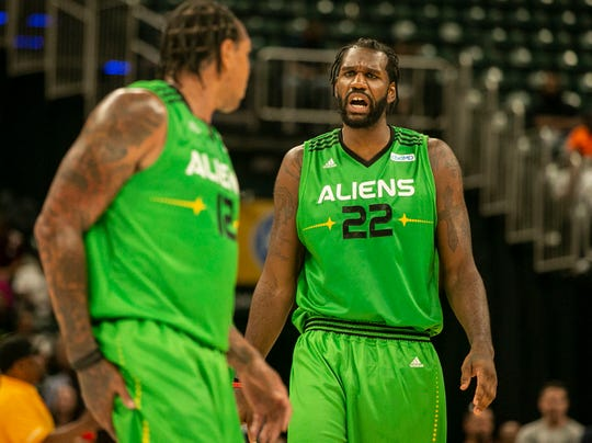 Aliens player Greg Oden (22) yells for Shannon Brown (12) during the Big 3 game at Bankers Life Fieldhouse, Indianapolis, Sunday, June 23, 2019.