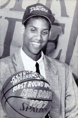 Reggie Miller smiles after receiving a basketball as a memento from the Indiana Pacers as their first round draft pick in this photo from June 24,1987.