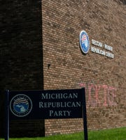 The Michigan GOP headquarters on Seymour Street in downtown Lansing shows a profanity painted on the facade of the building. Police believe the graffiti was painted there early Saturday.
