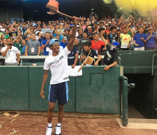 Memphis Grizzlies No. 2 overall draft pick Ja Morant holds the remnants of a guitar he smashed before Saturday night's 901 FC match at AutoZone Park.