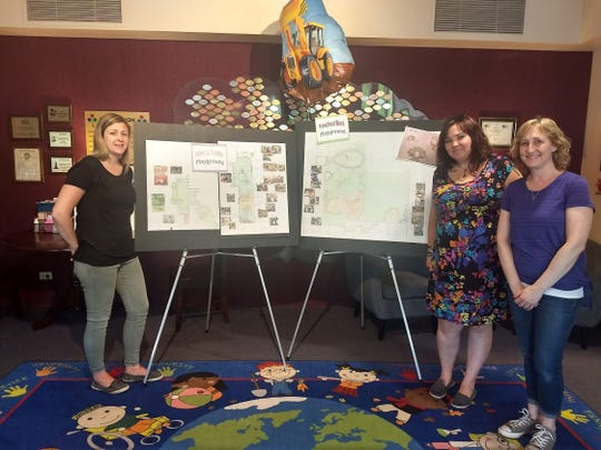 Menomonee Falls Children's Community Center teachers (from left) Laurie McCormick, Kendel Thiesenhusen and Shannon Gagnon show off the design for a custom-made, curriculum-based playground that is projected to be completed the second week of September.