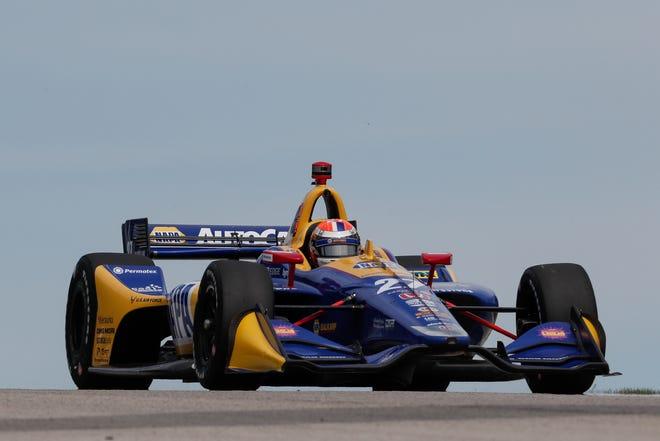 Alexander Rossi crests a hill at Road America.