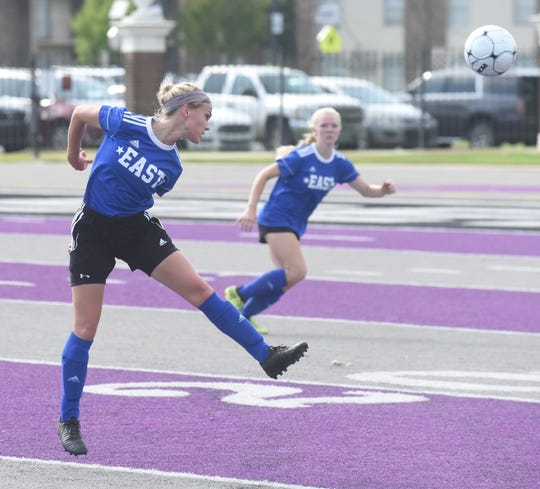 Mountain Home's Shelbie Kelly redirects the ball on Friday in the AHSCA All-Star soccer game in Conway.