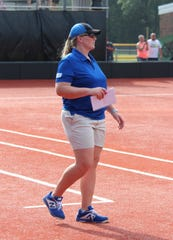 Mountain Home coach Shelby Anderson coaches for the East during the Arkansas High School Coaches Association All-Star softball games on Friday night in Conway.