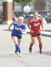 Mountain Home's Emma Jones of the East tracks down the ball during the AHSCA All-Star soccer game Friday in Conway.