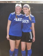 Mountain Home Lady Bomber soccer players Emma Jones (left) and Shelbie Kelly played for the East squad Friday night in the AHSCA All-Star games in Conway.