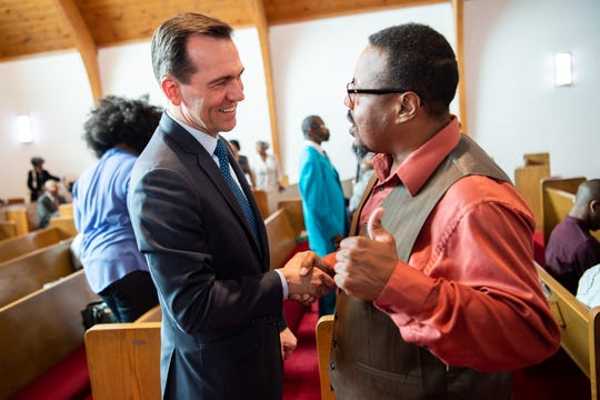 Rep. John Ray Clemmons, left, greets Terry Prather during a service at Kayne Avenue Missionary Baptist Church in Nashville on Sunday, June 23, 2019.