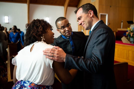 Rep. John Ray Clemmons greets the Rev. Harmon E. Stockdale Jr., center, and his wife, Jennifer, during a service at Kayne Avenue Missionary Baptist Church in Nashville on Sunday, June 23, 2019.