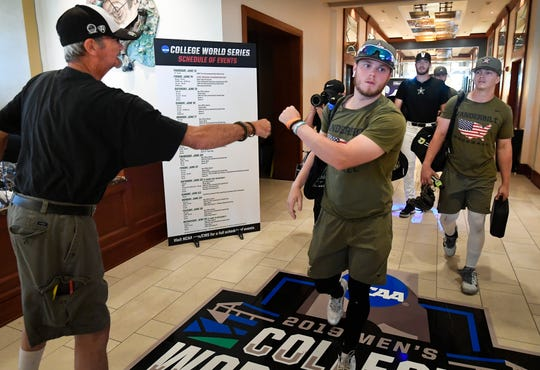 """Danny """"Goose"""" Jones greets Vanderbilt baseball players at their hotel in Omaha, Neb., as they head to their game against Louisville on Friday in the College World Series."""