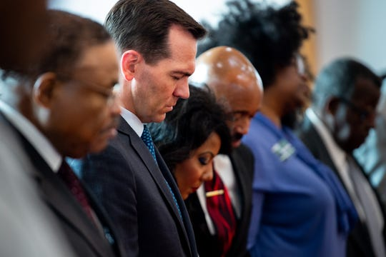 Rep. John Ray Clemmons gathers with others during a service at Kayne Avenue Missionary Baptist Church in Nashville on June 23, 2019.