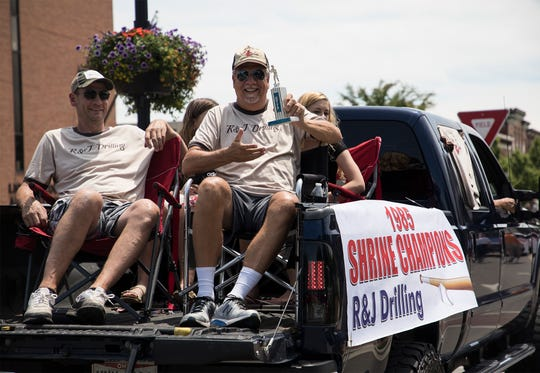Champions from previous Licking County Shrine tournaments came out to ride in the parade Saturday celebrating the event's 75th year, including members of the 1985 R & J Drilling team.