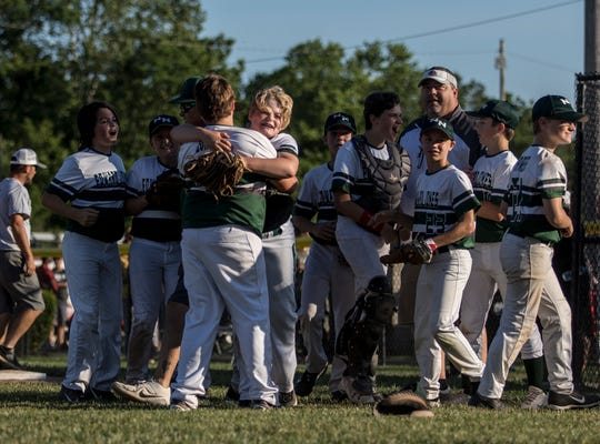 Edward Jones Investments celebrates its 5-0 win over Mattingly Landscape on Saturday in the Varsity semifinals of the Licking County Shrine Tournament. Edward Jones will be back at Mound City Thursday evening to play North Newark's Park National Bank for the title.
