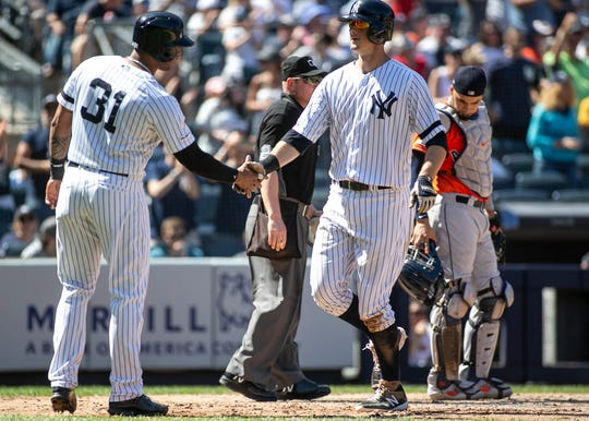 Jun 23, 2019; Bronx, NY, USA; New York Yankees third baseman DJ LeMahieu (26) is greeted at home by center fielder Aaron Hicks (31) after hitting a three run home run in the fifth inning against the Houston Astros at Yankee Stadium.